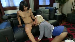 Blonde tattooed tranny gobbles a huge cock
